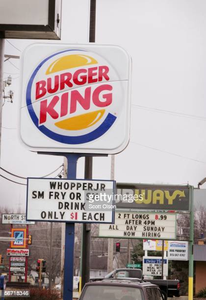 A burger King sign stands next to a sign for competitor Subway along the main street through downtown February 1 2006 in Belvidere Illinois The...