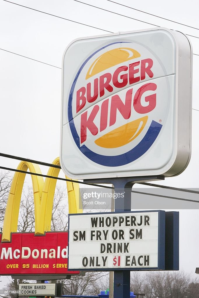 A burger King sign stands next to competitor McDonalds along the main street through downtown February 1, 2006 in Belvidere, Illinois. The restaurant chain's parents company Burger King Holdings Inc. said today it plans to sell shares to the public for the first time in the chain's 52-year history