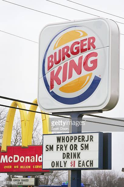 A burger King sign stands next to competitor McDonalds along the main street through downtown February 1 2006 in Belvidere Illinois The restaurant...