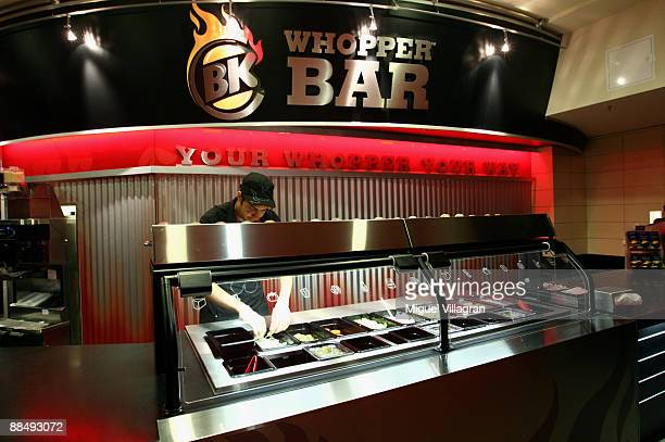 Burger King staff member worka at the Whopper Burger during the opening of the first European Whopper Bar on June 15 2009 in Munich Germany Customers...
