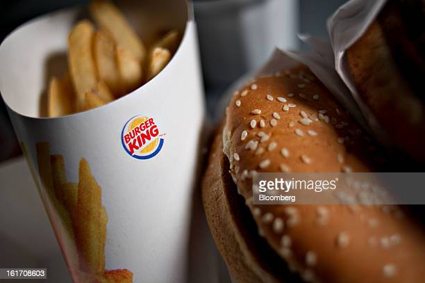 A Burger King Whopper hamburger is arranged with french fries for a photograph in Tiskilwa Illinois US on Wednesday Feb 13 2013 Burger King Worldwide...