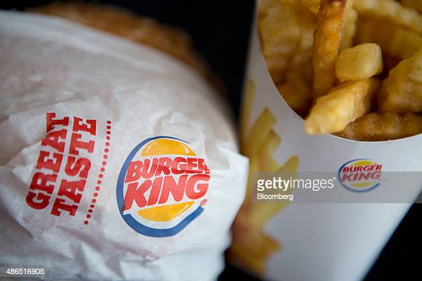 A Burger King Worldwide Inc Whopper hamburger and Satisfries are arranged for a photograph in Washington DC US on Thursday April 24 2014 Burger King...
