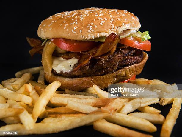 Burger King's 'Angry Triple Whopper' with three beef patties bacon pepper jack cheese Jalapeno peppers 'Angry' onions tomatoes lettuce and 'Angry'...