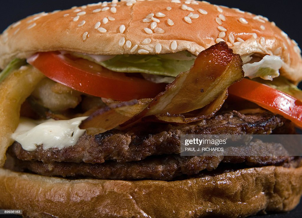 http://media.gettyimages.com/photos/burger-kings-angry-triple-whopper-with-three-beef-patties-bacon-jack-picture-id89936163