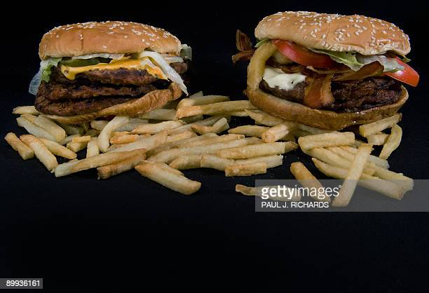 Burger King's two big boy burgers the 'BK Quad Stacker' with four beef patties topped with bacon cheese sauce lettuce pickles onions seen August 19...