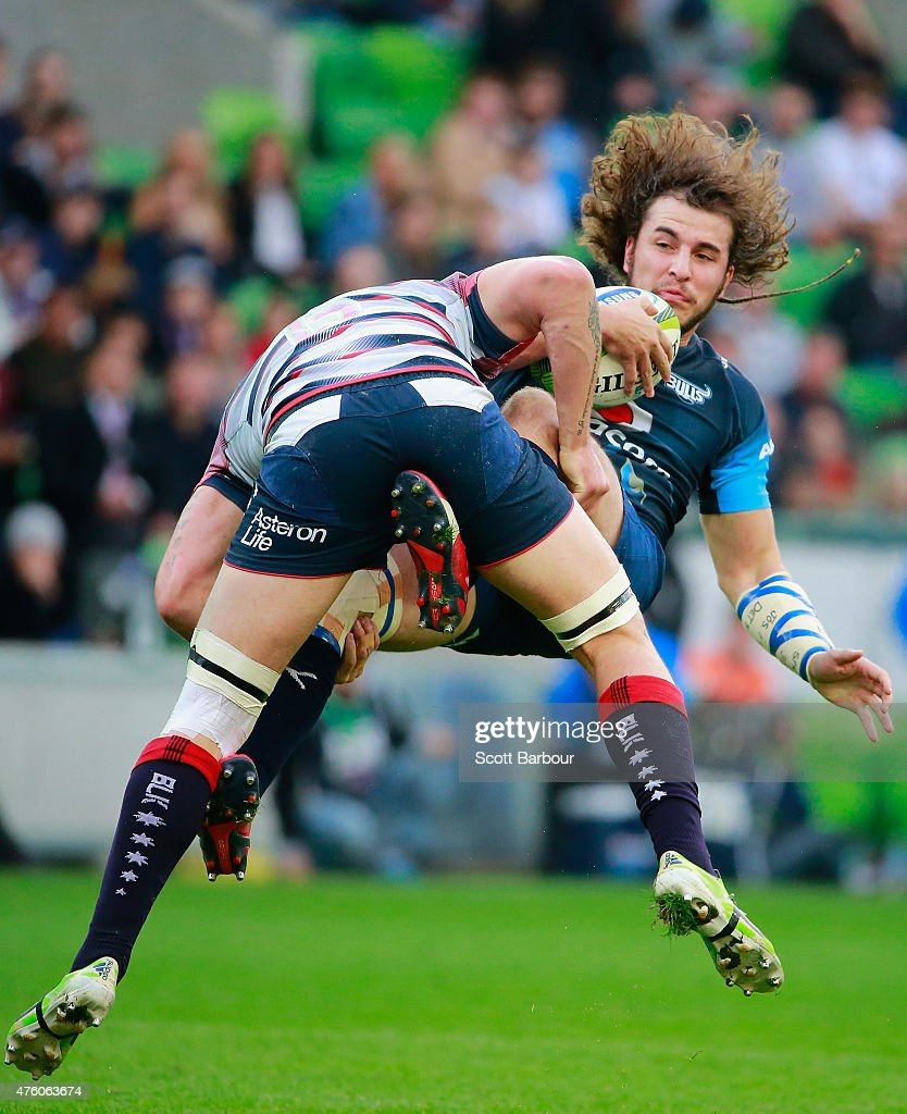 Burger Odendaal of the Bulls is tackled by <a gi-track='captionPersonalityLinkClicked' href=/galleries/search?phrase=Sean+McMahon+-+Rugby+Player&family=editorial&specificpeople=13709100 ng-click='$event.stopPropagation()'>Sean McMahon</a> of the Rebels during the round 17 Super Rugby match between the Rebels and the Bulls at AAMI Park on June 6, 2015 in Melbourne, Australia.