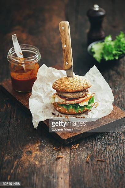 Burger with lettuce, tomato, meat and fried onion