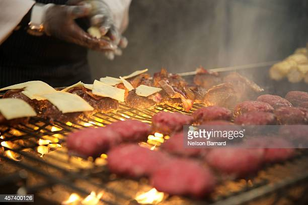 Burgers are prepared at the Blue Moon Burger Bash presented by Pat LaFrieda Meats hosted by Rachael Ray during the Food Network New York City Wine...