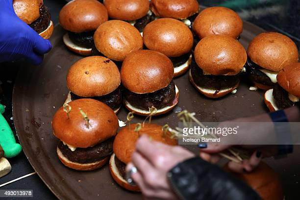 Burgers are prepared during the Blue Moon Burger Bash presented by Pat LaFrieda Meats hosted by Rachael Ray Food Network Cooking Channel New York...