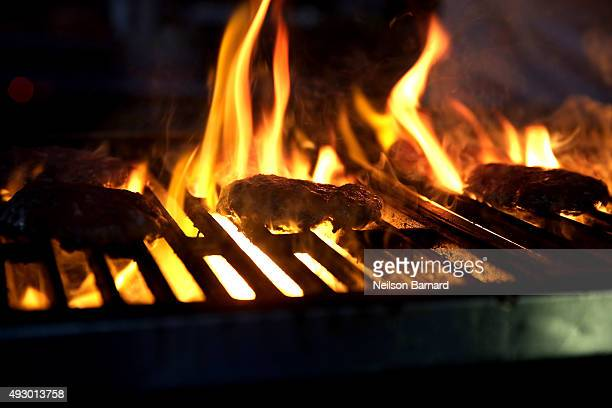 Burgers cook on a grill during the Blue Moon Burger Bash presented by Pat LaFrieda Meats hosted by Rachael Ray Food Network Cooking Channel New York...