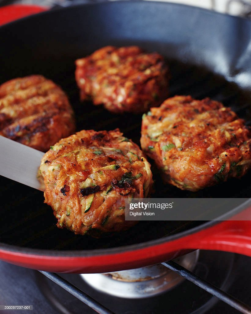 Burgers in frying pan : Stock Photo