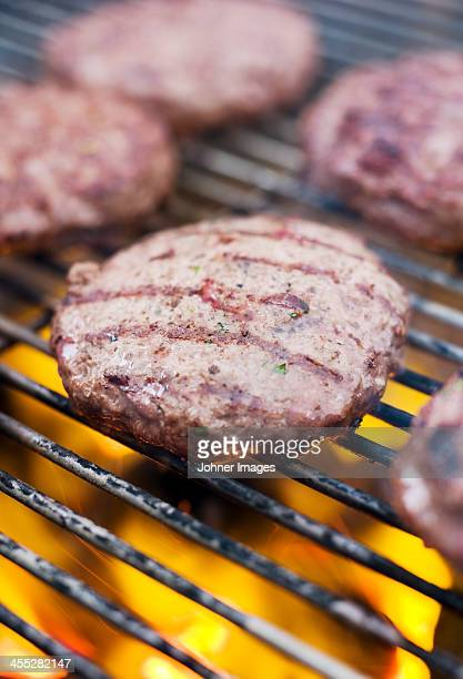 Burgers on grill, close-up