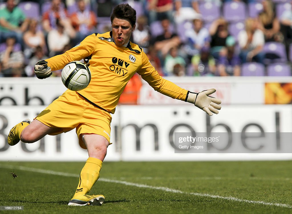 Burghausen's goalkeeper Rene Vollath plays the ball during the Third League match between VfL Osnabrueck and Wacker Burghausen at Osnatel Arena on May 4, 2013 in Osnabruck, Germany.