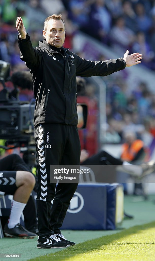 Burghausen's head-coach Georgi Donkov gestures during the Third League match between VfL Osnabrueck and Wacker Burghausen at Osnatel Arena on May 4, 2013 in Osnabruck, Germany.