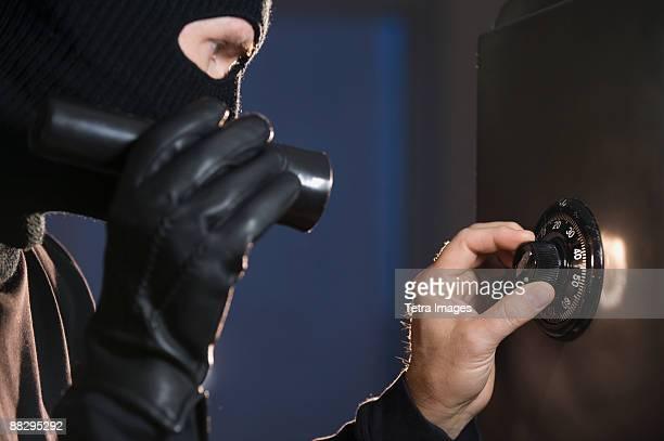 Burglar cracking safe