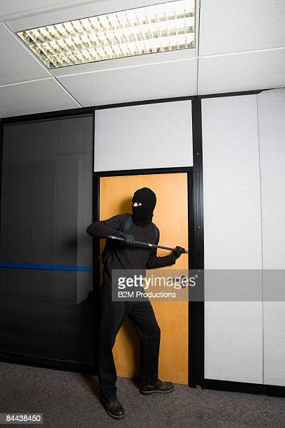 Burglar trying to Open a Door