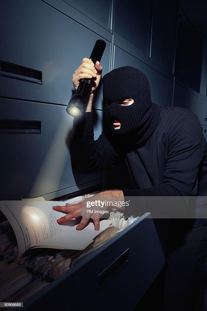 Burglar with files : Stock Photo
