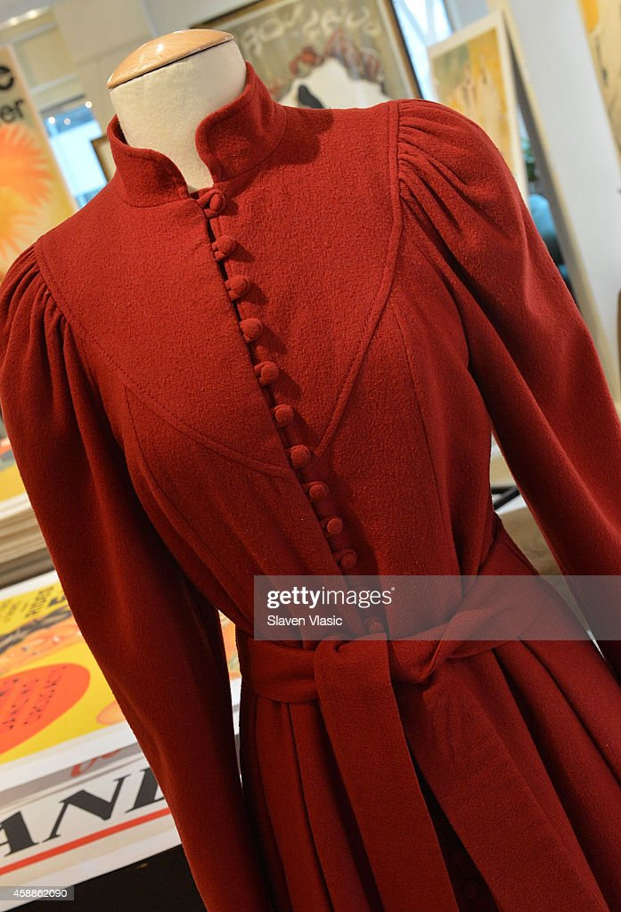 A burgundy wool coat dress designed by Caroline Charles and worn by HRH Princess Diana in 1982 while visiting the Milan Asian Community Playgroup in Wandworth, London and in 1983 at Aberdeen Airport while carrying Prince William, to be auctioned by Julien's Auctions of Beverly Hills December 5-6, 2014 on display at Ross Art Gallery on November 12, 2014 in New York City.