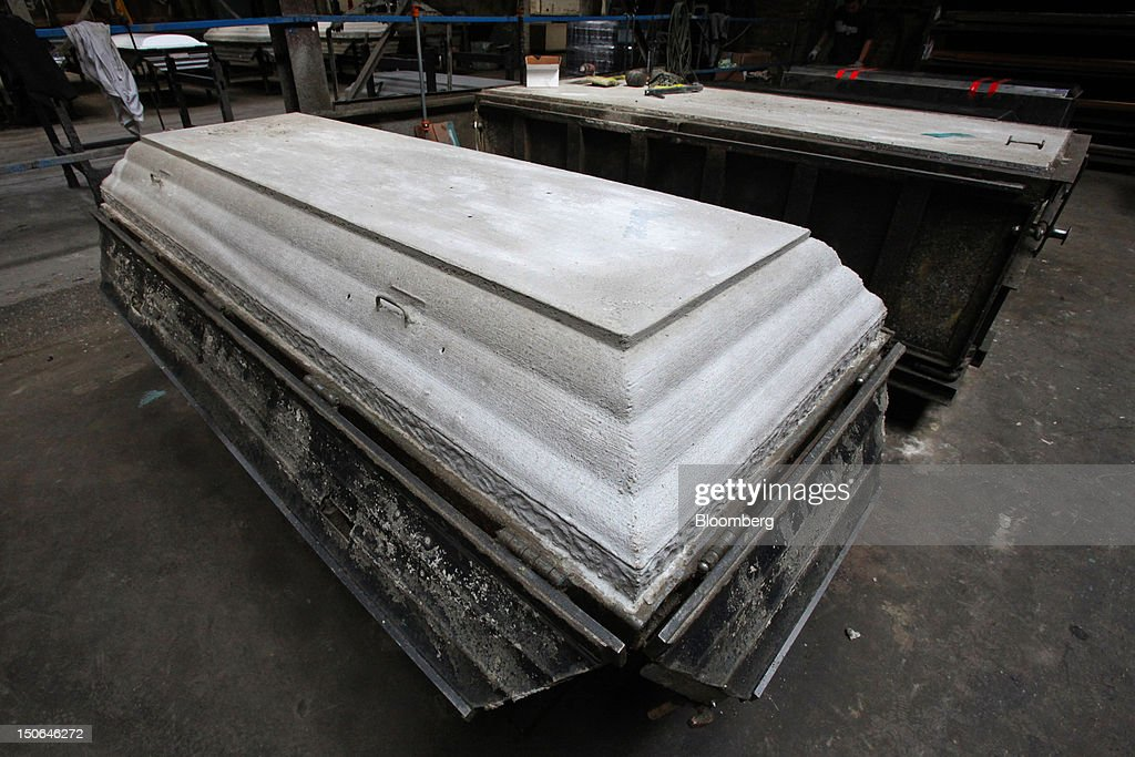 A burial vault cover sits on display fresh out of its form at the American Wilbert Vault Corp. manufacturing facility in Des Plaines, Illinois, U.S., on Thursday, Aug. 23, 2012. Several U.S. Presidents including John F. Kennedy and Ronald Reagan, and other famous people including Al Capone, Louis Armstrong, Elvis Presley and Frank Sinatra are buried in American Wilbert burial vaults, according to the company. The U.S. Census Bureau is expected to release data on orders for durable goods on Aug. 24. Photographer: Tim Boyle/Bloomberg via Getty Images