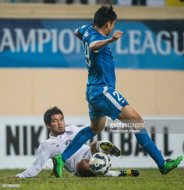 Buriram United midfielder Surat Sukha fights for the ball with Guangzhou RF forward Zhang Shuo during the AFC Champions League 2015 Group Stage F...