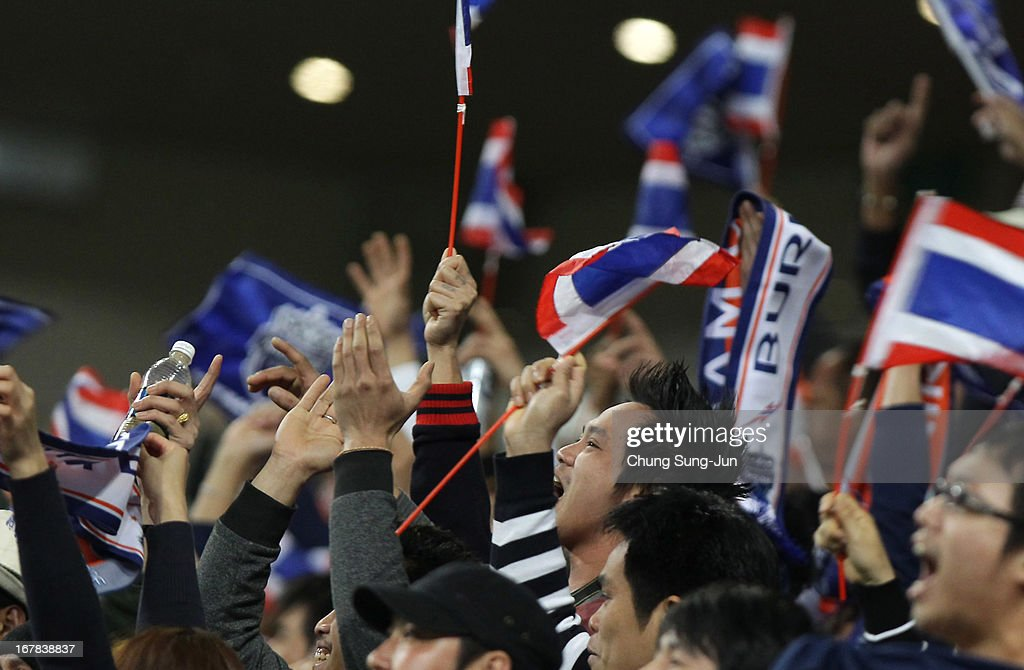 Buriram United supporters celebrate after advanced to the round of 16 after the AFC Champions League Group E match between FC Seoul and Buriram United at Seoul World Cup Stadium on May 1, 2013 in Seoul, South Korea.