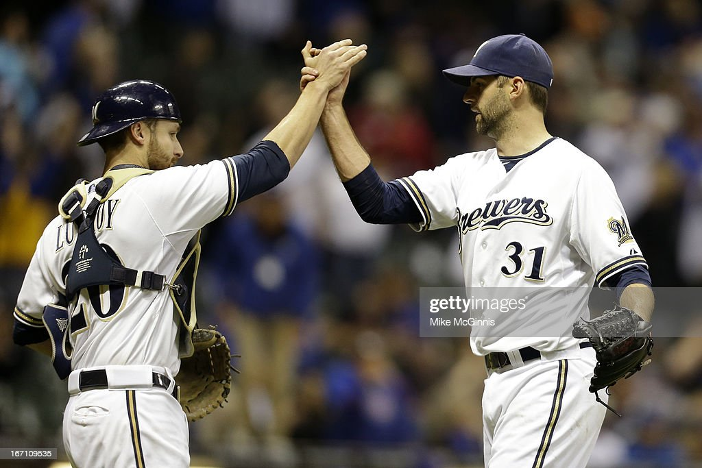 <a gi-track='captionPersonalityLinkClicked' href=/galleries/search?phrase=Burke+Badenhop&family=editorial&specificpeople=4901342 ng-click='$event.stopPropagation()'>Burke Badenhop</a> #31 of the Milwaukee Brewers celebrates with <a gi-track='captionPersonalityLinkClicked' href=/galleries/search?phrase=Jonathan+Lucroy&family=editorial&specificpeople=5732413 ng-click='$event.stopPropagation()'>Jonathan Lucroy</a> #20 after the 5-1 win over the Chicago Cubs during the game at Miller Park on April 20, 2013 in Milwaukee, Wisconsin.