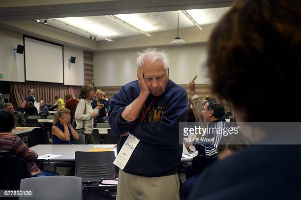 Burke Cueny of Rochester watches as volunteers and city officials participate in a recount after a federal judge ordered the statewide recount at the...