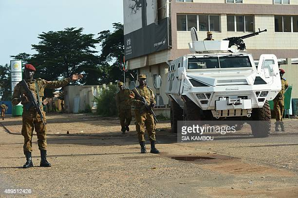 Burkina Faso army troops stand guard outside Guillaume Ouedraogo military camp in Ouagadougou on September 22 2015 Burkina Faso army troops have...