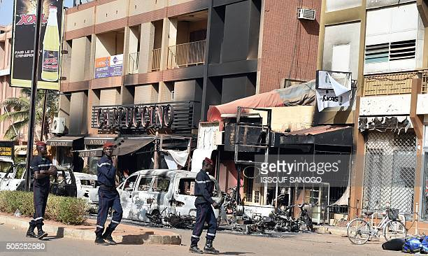 A Burkina Faso fire brigade walks past the Cappuccino restaurant following a jihadist attack in Ouagadougou on January 16 2016 At least 26 people...