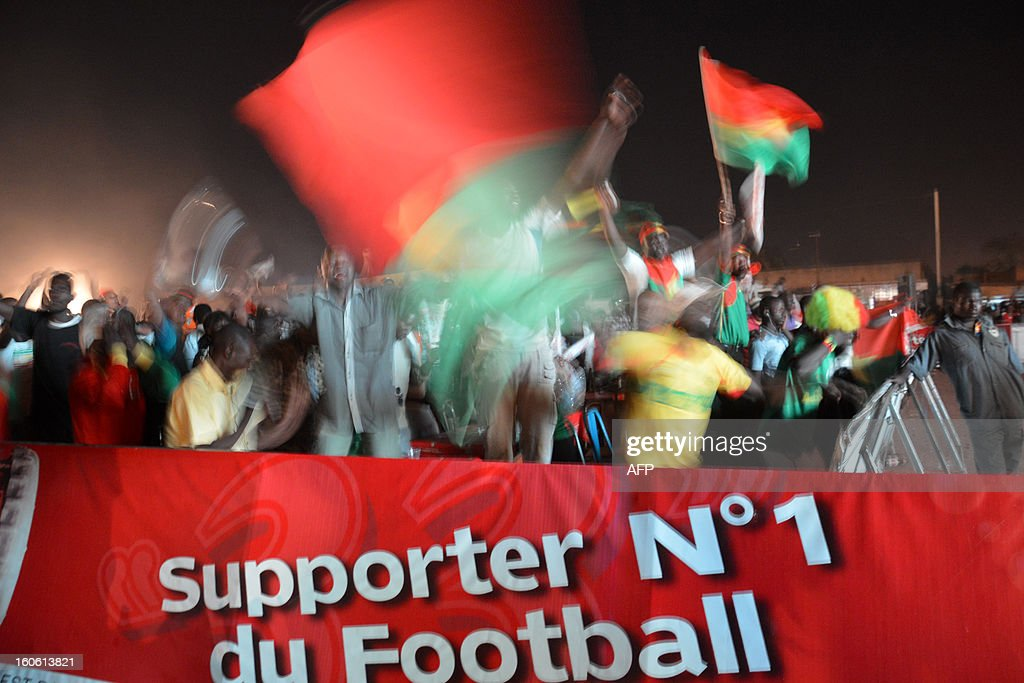Burkina Faso football supporters cheer during the African Cup of Nation 2013 quarter final football match between Burkina Faso and Togo, in Ouagadougou on February 3, 2013. Burkina Faso qualified for the semi-finals of the 2013 Africa Cup of Nations Sunday by pipping Togo 1-0 after extra time.