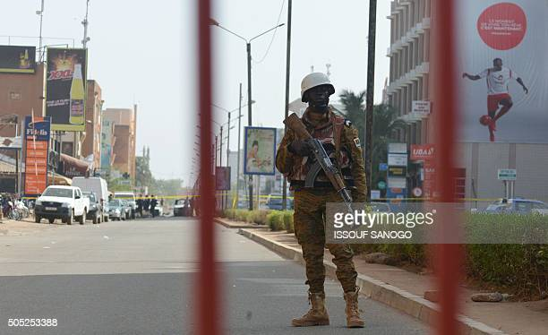 A Burkina Faso gendarme stands guard outside the Splendid hotel and the Cappuccino restaurant following a jihadist attack in Ouagadougou on January...