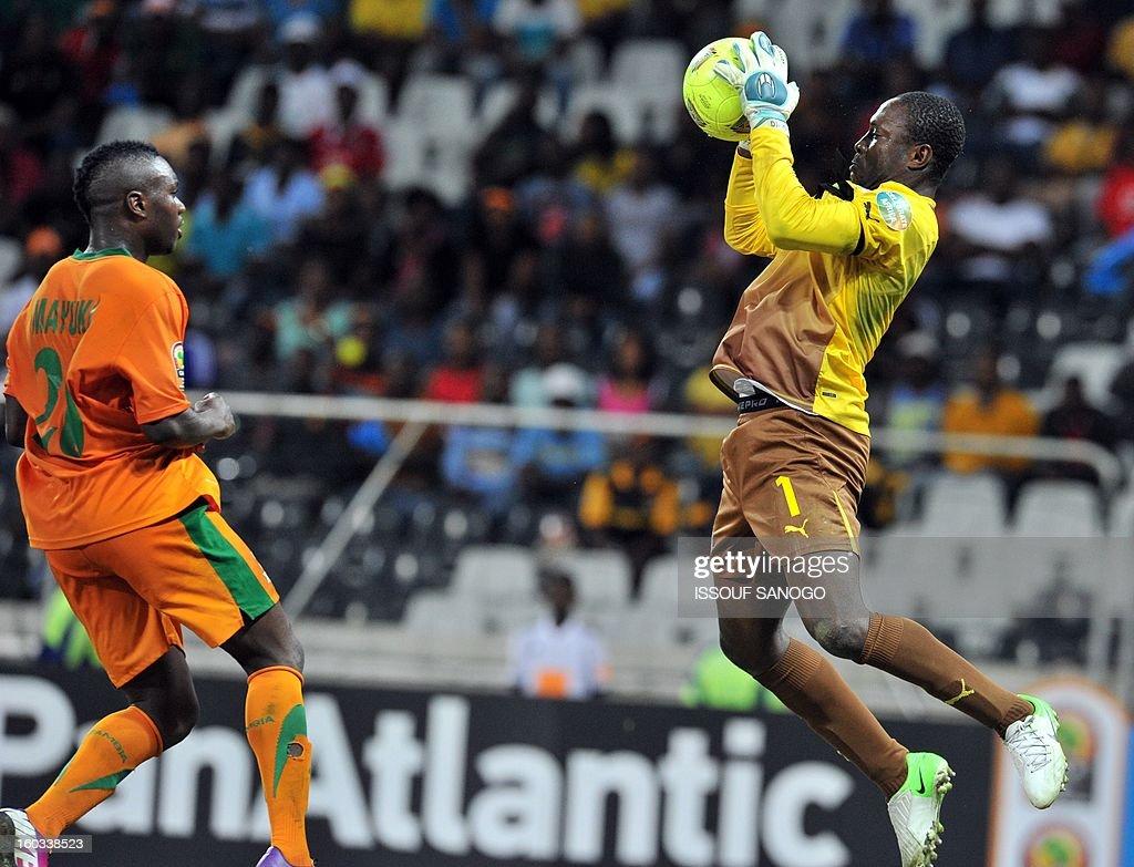 Burkina Faso goalkeeper Daouda Diakite R faces Zambia forward