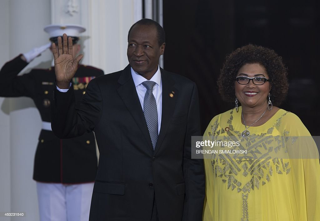 Burkina Faso President Blaise Compaore arrives with his wife Chantal Compaore at the White House for a group dinner during the US Africa Leaders Summit August 5, 2014 in Washington, DC. AFP PHOTO/Brendan SMIALOWSKI