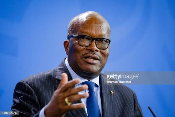 Burkina Faso President Roch Marc Kabore speaks to the media on March 21 2017 in Berlin Germany