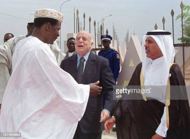 Burkina Faso 's President Blaise Compaore is greeted by Dr Azeddine Laraki president of the Organisation of the Islamic conference and Hamed Ben...