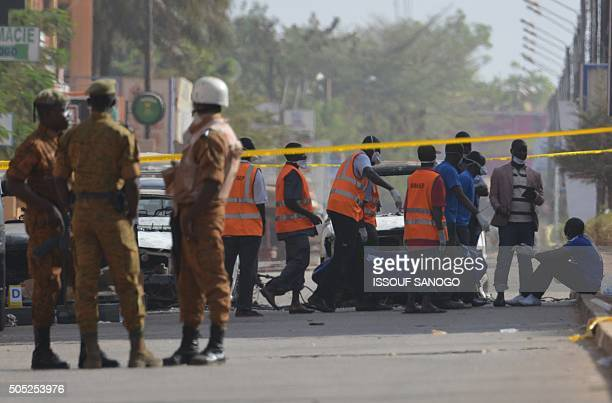 Burkina Faso troops oversee the evacuation of bodies outside the Splendid hotel and the Cappuccino restaurant following a jihadist attack in...