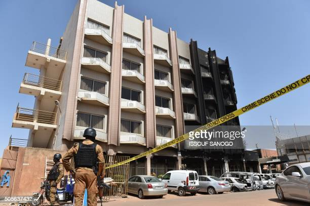 Burkina Faso troops stand guard outside Splendid Hotel in Ouagadougou on January 18 2016 following a jihadist attack by AlQaedalinked gunmen late on...