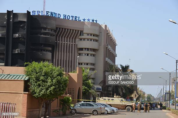 Burkina Faso troops stand guard outside the Splendid hotel and the nearby Cappuccino restaurant following a jihadist attack in Ouagadougou on January...