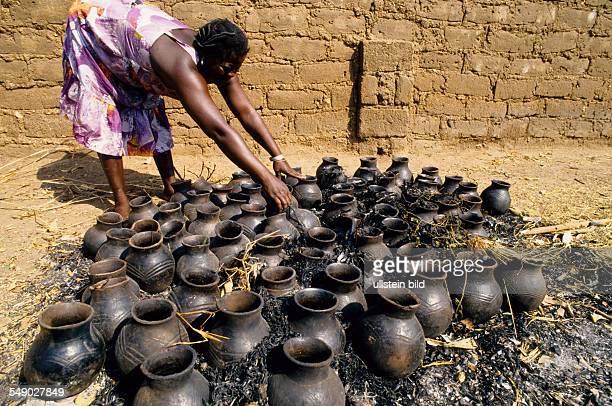 Woman burning pots for Miller beer