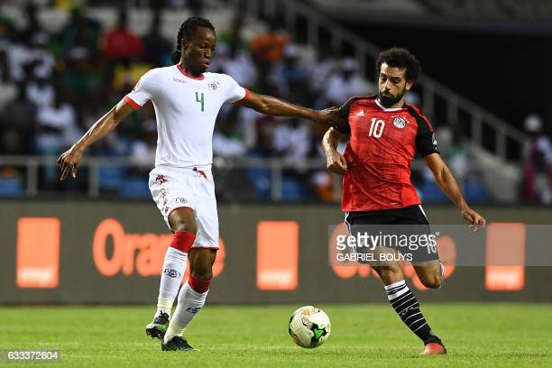 Burkina Faso's defender Bakary Kone challenges Egypt's forward Mohamed Salah during the 2017 Africa Cup of Nations semifinal football match between...