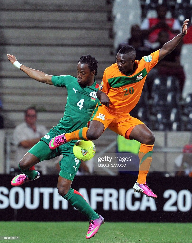 Burkina Faso s defender Bakary Kone L fight for the ball with