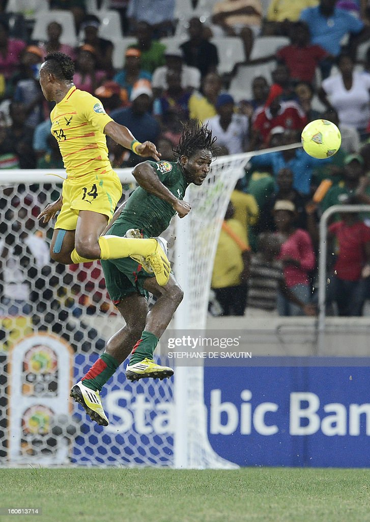 Burkina Faso's defender Bakary Kone (R) vies with Togo's midfielder Kossi Prince Segbefia during the African Cup of Nation 2013 quarter final football match Burkina Faso vsTogo, on February 3, 2013 in Nelspruit.