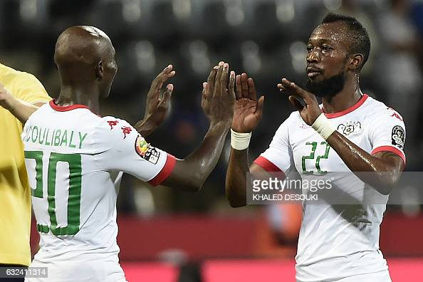 TOPSHOT Burkina Faso's defender Yacouba Coulibaly and Burkina Faso's midfielder Ibrahimi Blati Toure celebrate at the end of the 2017 Africa Cup of...