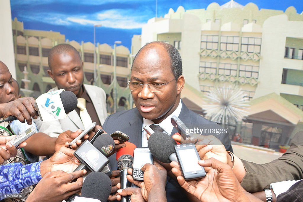 Burkina Faso's foreign Minister Djibrill Basole speaks to media after meeting with representatives of Touareg rebels and Malian government on June 10, 2013 at the presidential palace in Ouagadougou. AFP PHOTO / AHMED OUOBA