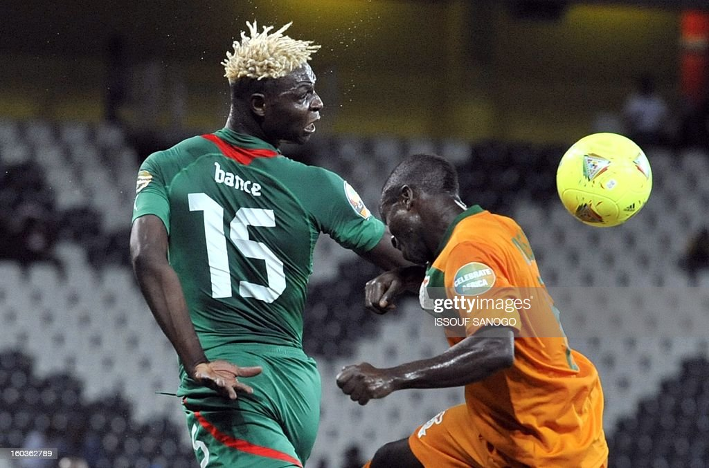 Burkina Faso's forward Aristide Bance (L) fights for the ball with Zambia's midfielder Isaac Chansa (R) during Burkina Faso vs Zambia Africa Cup of Nations group C football match at Mbombela stadium in Nelsprit on January 29, 2013. AFP PHOTO / ISSOUF SANOGO