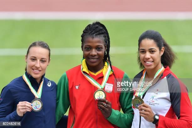 Burkina Faso's gold medallist Marthe Koala poses on the podium with France's silver medallist Pauline Lett and Canada's bronze medallist Ashlea...