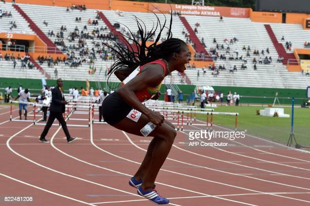 TOPSHOT Burkina Faso's Marthe Koala celebrates after winning women's 100m hurdles at the Felix HouphouetBoigny Stadium in Abidjan during the 8th...