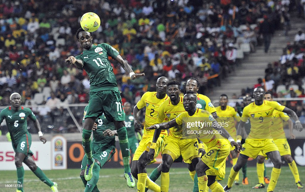 Burkina Faso's midfielder Jonathan Pitroipa (foreground L) heads the ball to score a goal during the African Cup of Nation 2013 quarter final football match Burkina Faso vsTogo, on February 3, 2013 in Nelspruit.