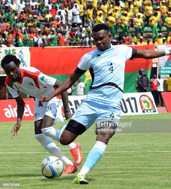 Burkina Faso's National football team forward Jonathan Pitroipa fights for the ball with Botswana's Mosha Gaolaolwe at the stade du 4 aout in...