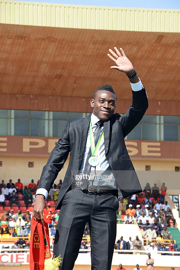 Burkina Faso's national football team midfielder Alain Traore waves to some 40,000 spectators on February 12, 2013 during celebrations at the 4-aout stadium in Ouagadougou, two days after their first ever final football match of an Africa Cup of Nations.